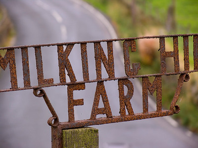 Rusty sign marks 'Milking Hill Farm' entrance near Stanbury cemetery