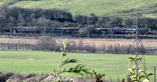 A crummy photo, redeemed by the fact that it's taken from one mile away through my 7x zoom and heavily cropped from an 8MP image. This is the 10.45 Keighley to Bradford train, made up of the Class 333 in its original livery.